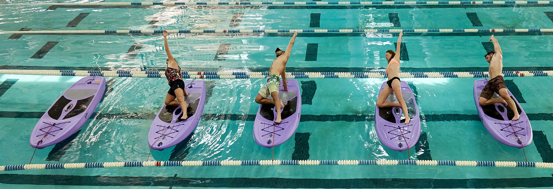 Water yoga on kayaks in the UWF indoor pool